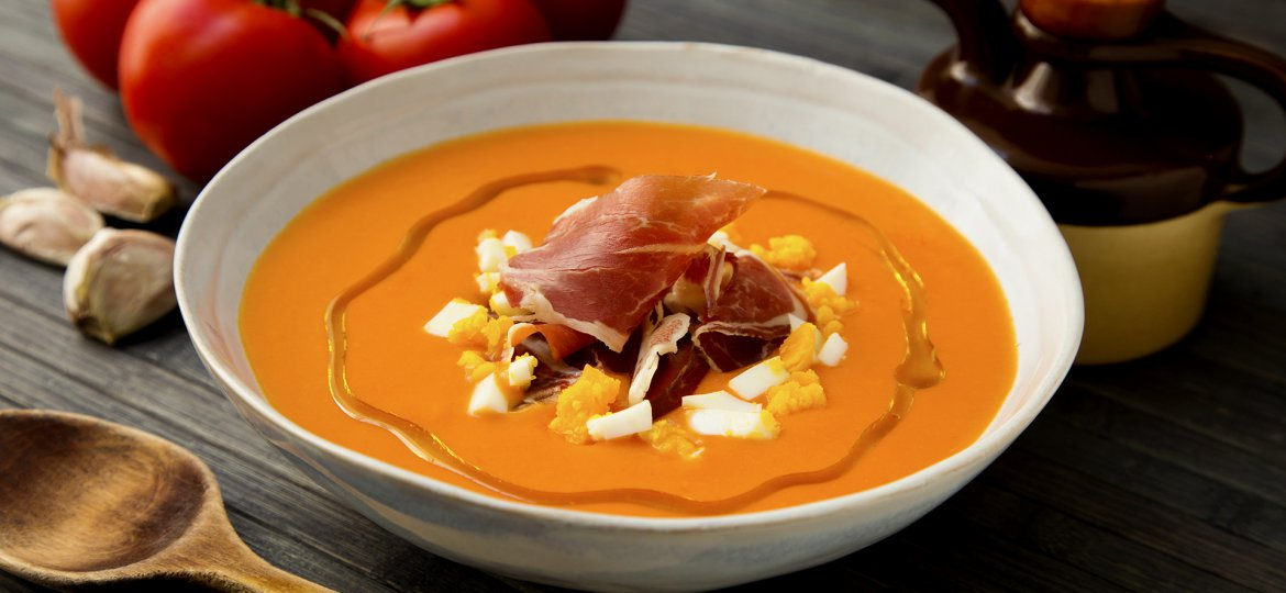 Traditional spanish salmorejo. Cold tomato soup served with egg